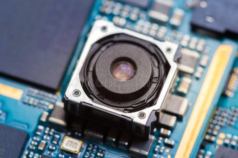 Cell phone camera module with other parts of device, service and repair concept stock images