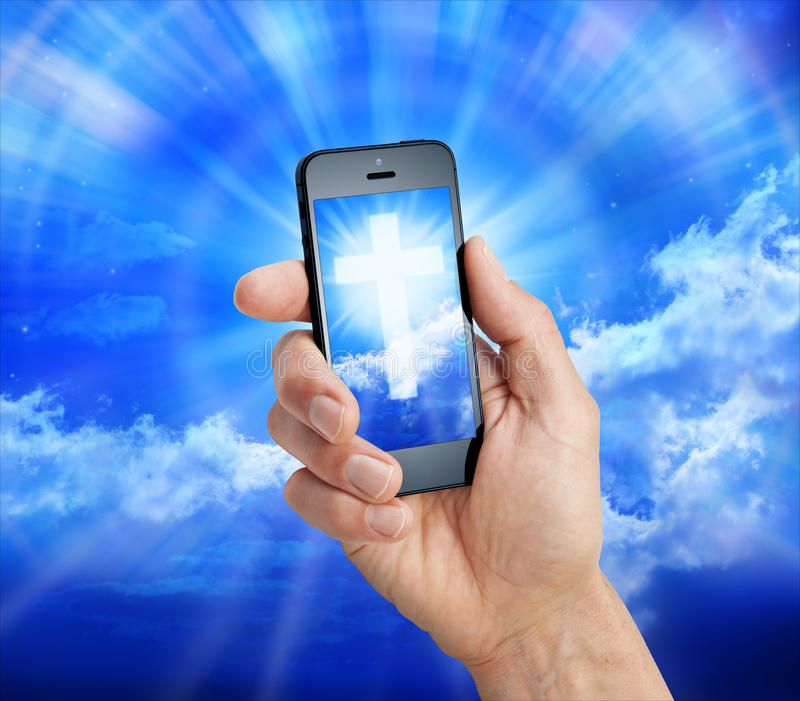 Cell Phone Christian Cross stock photography