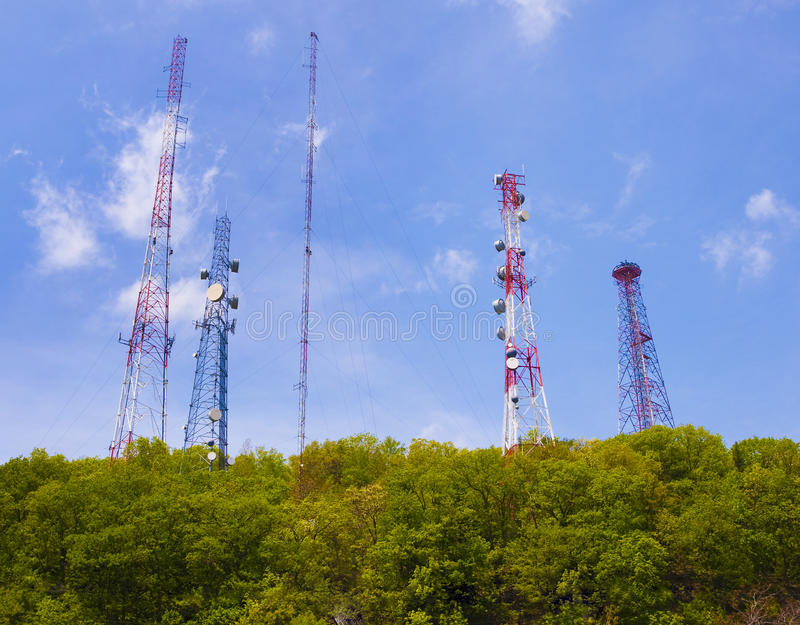 Cell phone and communication towers royalty free stock image