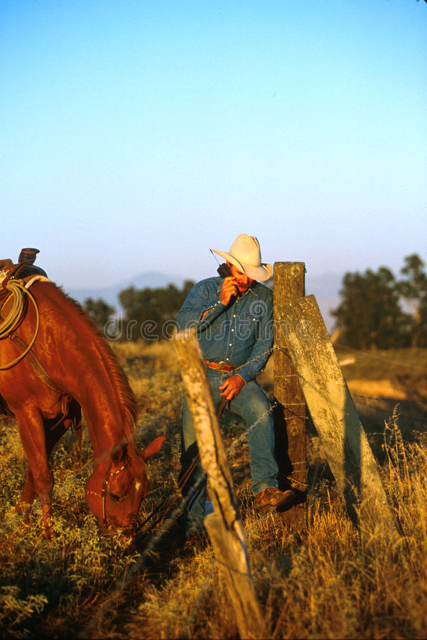 Cell phone cowboy stock images
