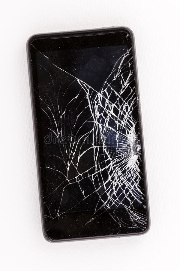A cell phone with a cracked broken screen. Studio shot of a broken cell phone on a white background stock photos