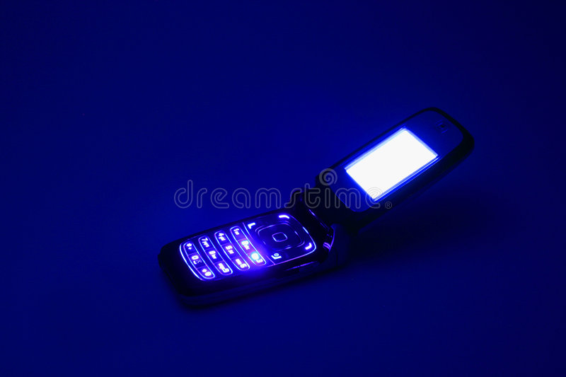 Cell Phone in the Dark royalty free stock photos
