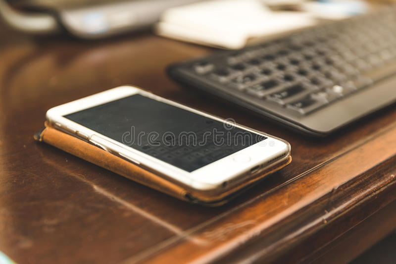 Cell phone on desk stock photo