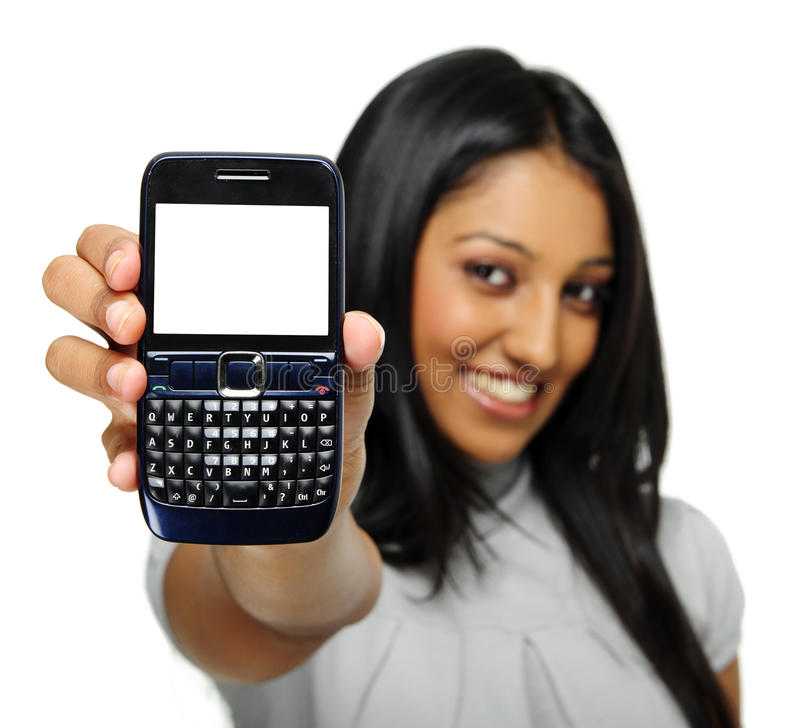 Cell phone display. Indian girl shows her phone to camera, copyspace provided on screen stock photography