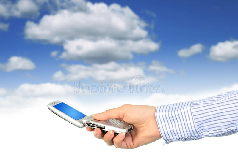 Cell phone in hand. stock photography