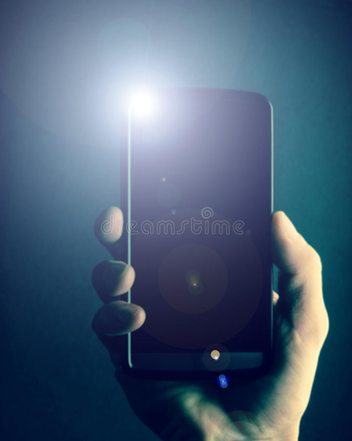 Cell phone in hand royalty free stock photography