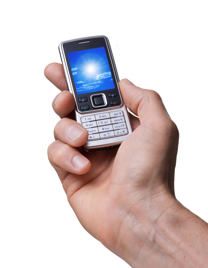 Cell Phone in Hand Photo. A cell phone being held in a mans hand isolated on white with a photo of the sky on the screen stock images