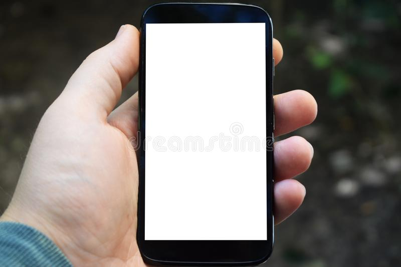 Cell phone in hand, place for advertisement, inscriptions. Background for advertising royalty free stock photos