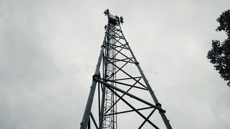 A cell phone mobile phone tower photo taken from below the tower royalty free stock photo