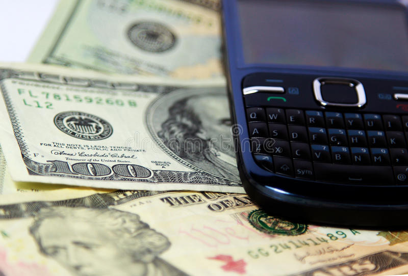 Cell Phone & Money stock photography
