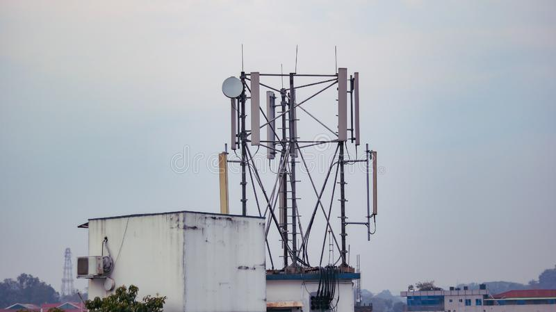 A cell phone network tower in daylight royalty free stock photos
