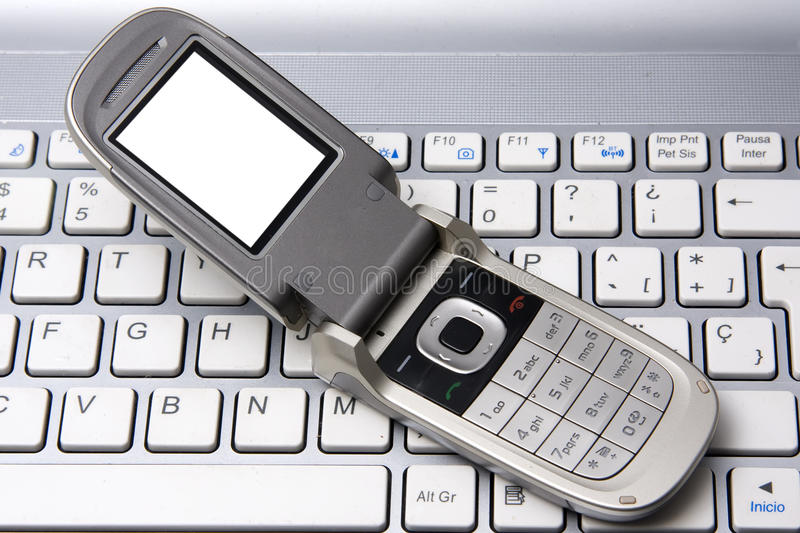 Cell phone and notebook stock photos
