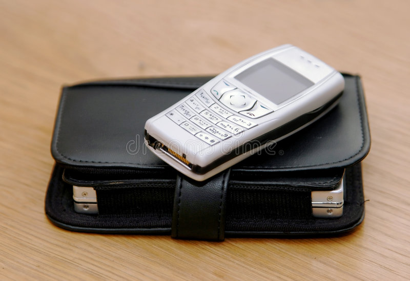 Cell phone and organizer stock image