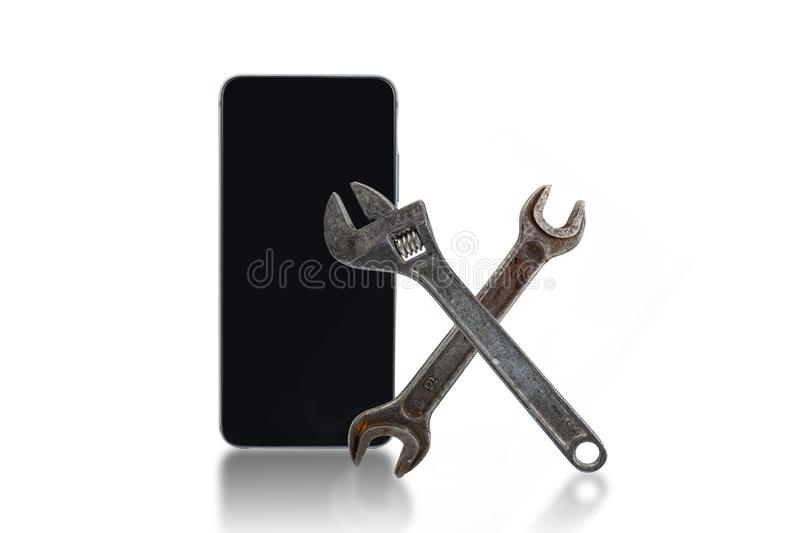 Cell phone repair concept. Cell phone, wrenches on a white background. Cellphone, equipment, mobile, technology, communication, telephone, smartphone, display stock photos
