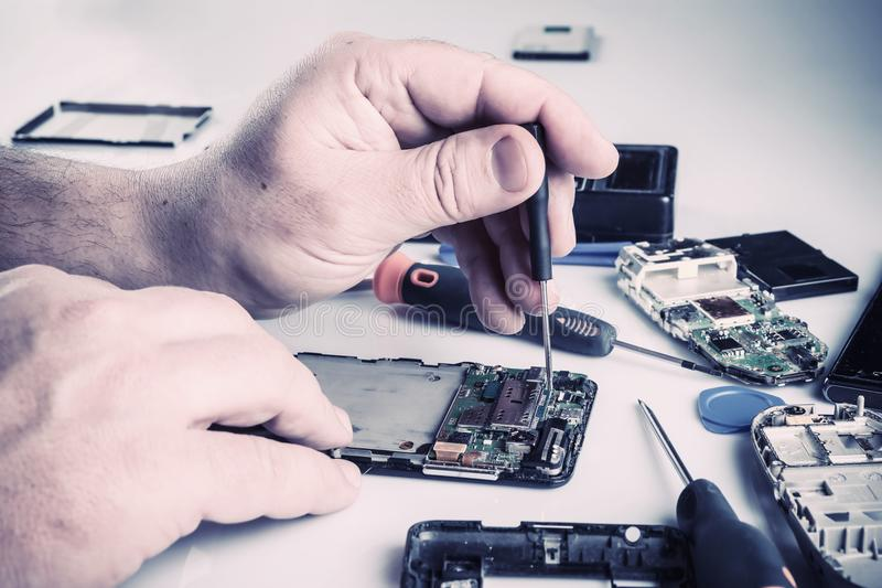 Cell phone repair royalty free stock images