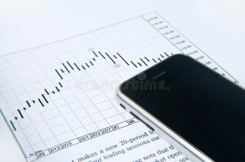 Download Cell Phone With Stock Chart Stock Image - Image: 12959563