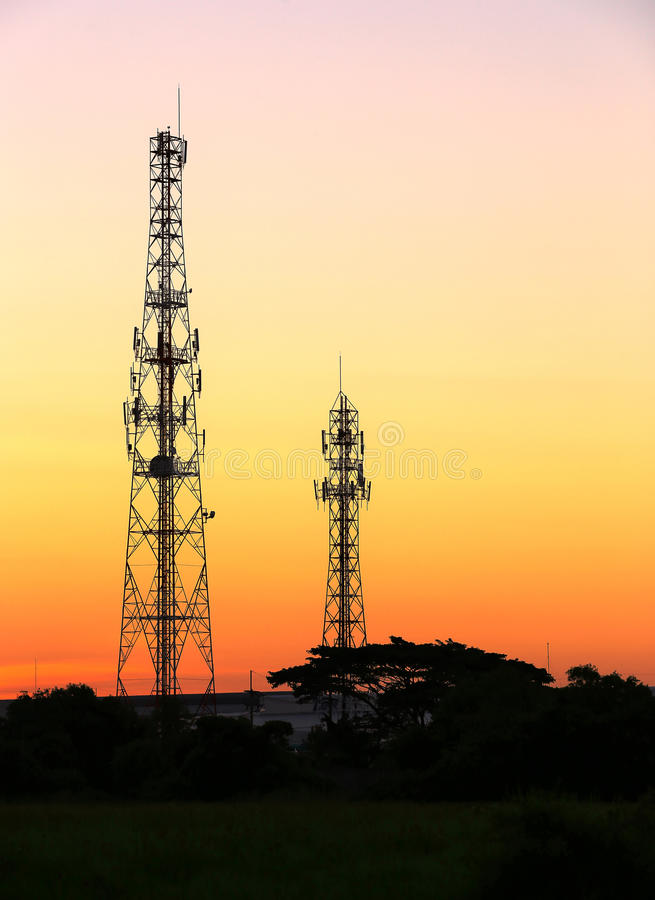 Cell phone tower and radio antenna. At sunrise royalty free stock photo