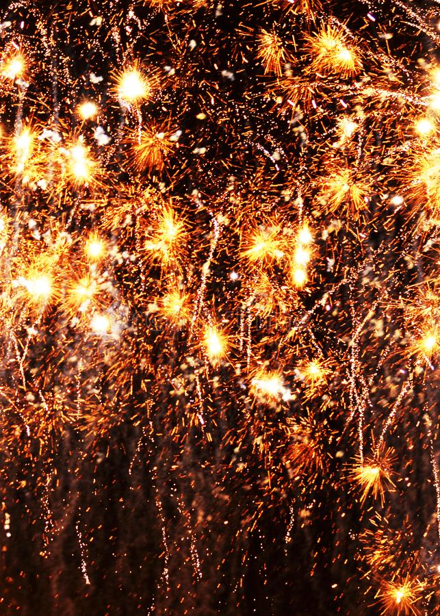 Cell phone wallpaper gold exploding fireworks black background royalty free stock images