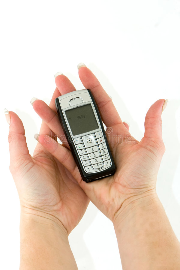 Cell phone in woman hands royalty free stock image