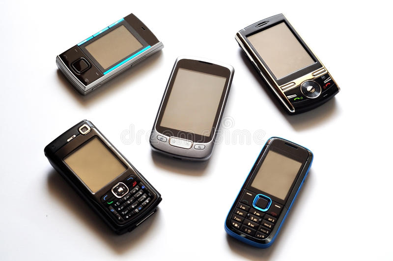 Cell phones. Different types of cell phones over white royalty free stock photos