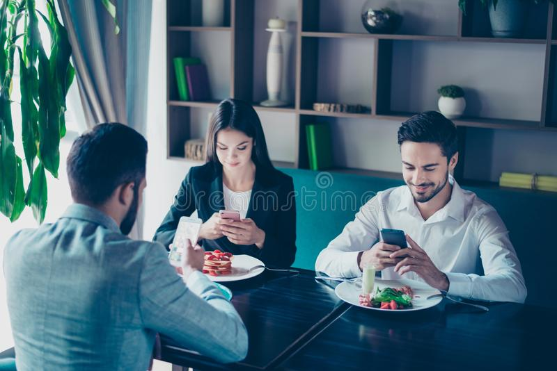 Cell phones addiction. New generation, busy people, lunch and me royalty free stock image