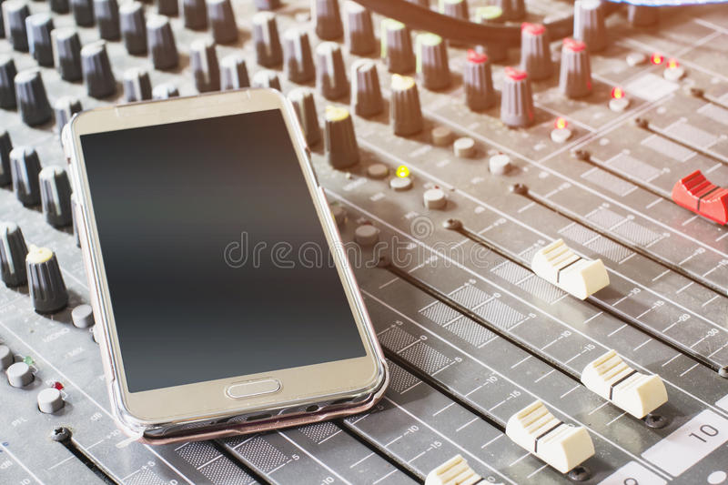 Cell phones on the audio mixer. In the Control Room stock photography