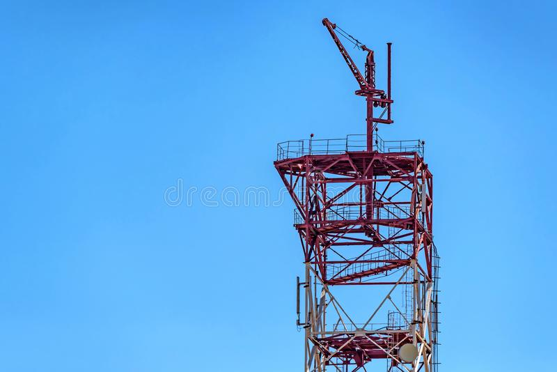 Top of cell tower with antennas. Cell tower antennas mounted on steel power poles against blue sky royalty free stock images