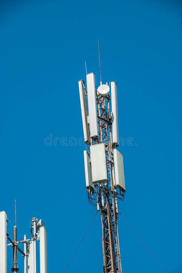 Cell tower and clear blue sky stock photos