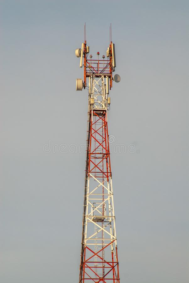 Cell tower ordinary. Tower of cellular communication of the ordinary in the sky stock photos
