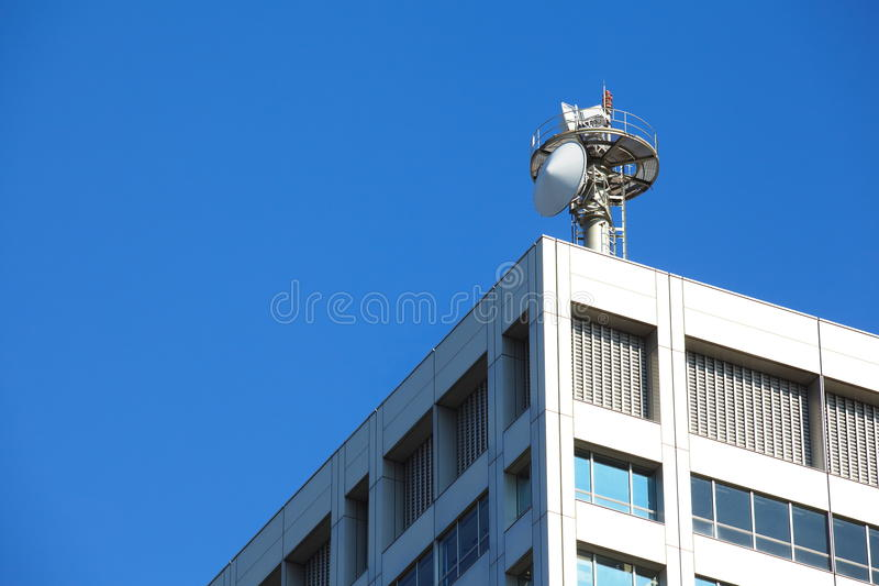 Cell tower and radio antenna. With blue sky stock image
