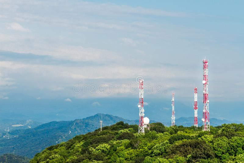 Cell towers on the hills royalty free stock images