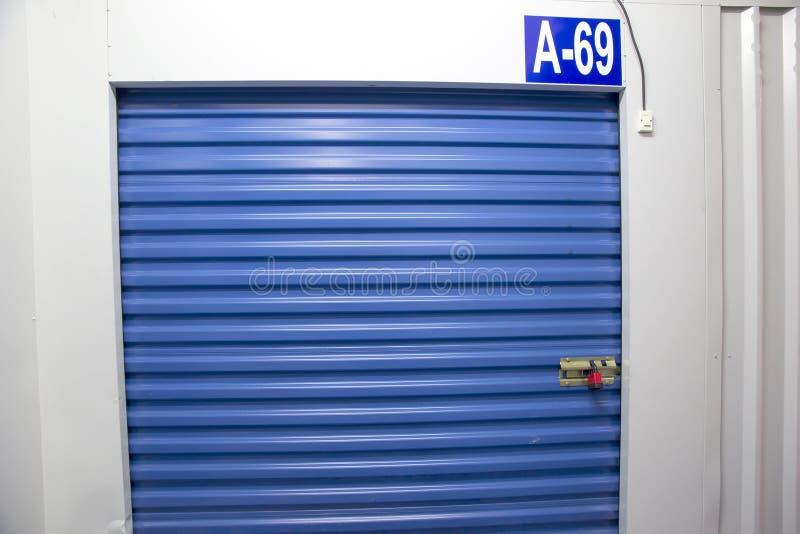 Cellar. Blue curtain cellar, small storage entrance stock photo