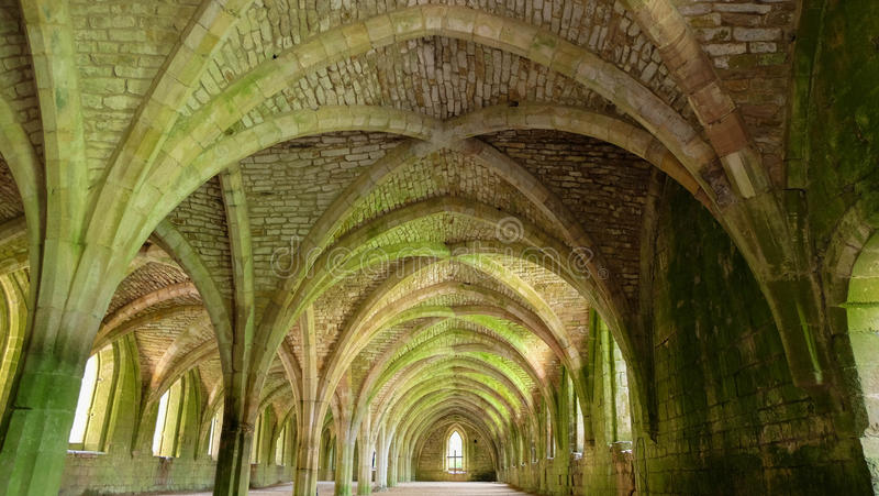 Cellarium of Fountains Abbey. The Gothic vaulted Cellarium (food storage) of Fountains Abbey, Ripon, the UK royalty free stock photo