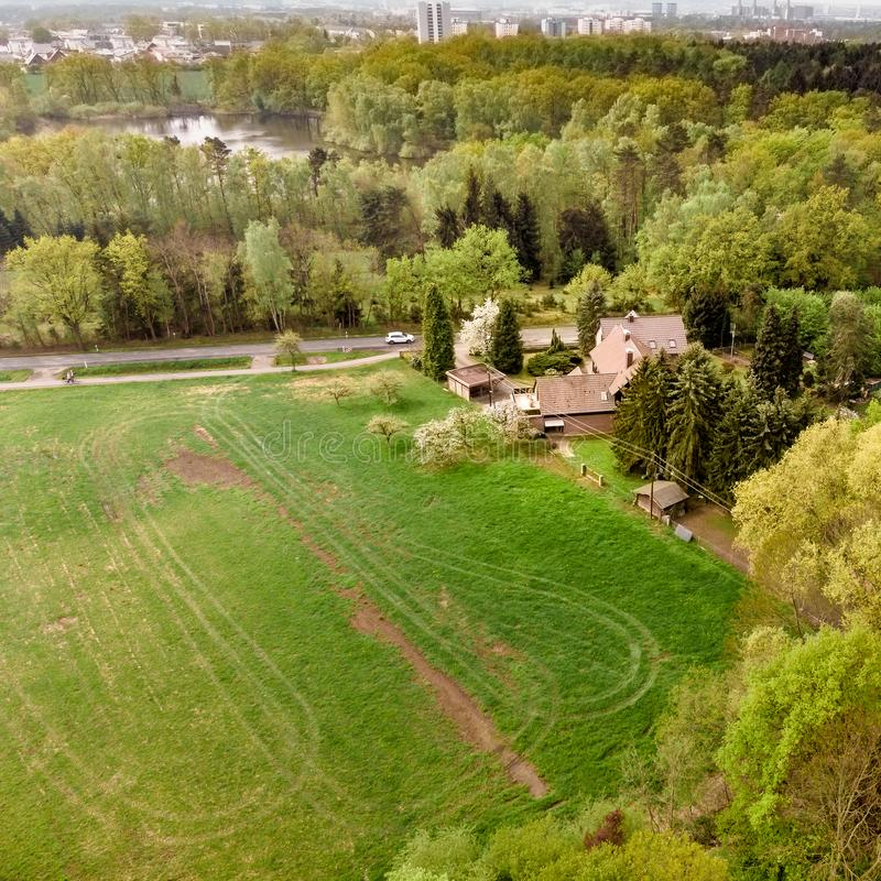 Celle, Lower Saxony, Germany, April 23., 2014: Aerial view of a house on the edge of a forest in front of a meadow behind a road stock images
