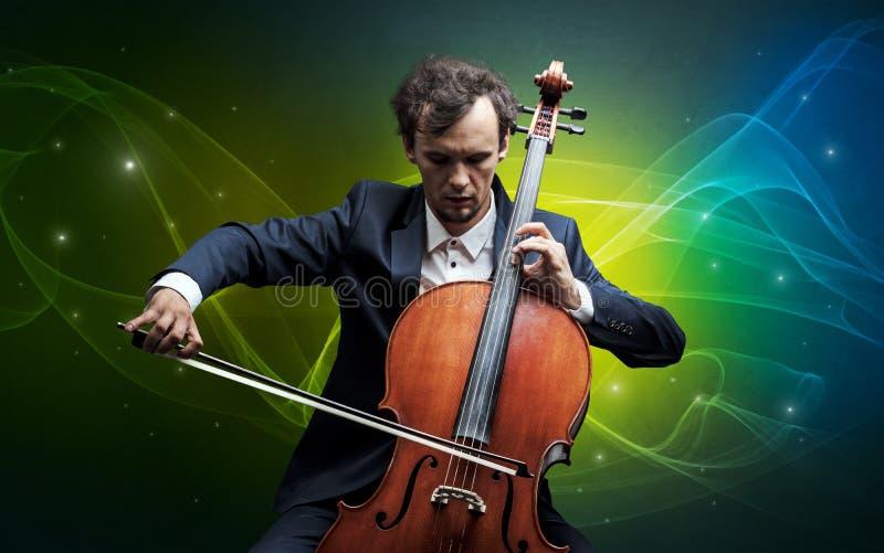 Cellist med färgrikt sago- begrepp royaltyfria foton