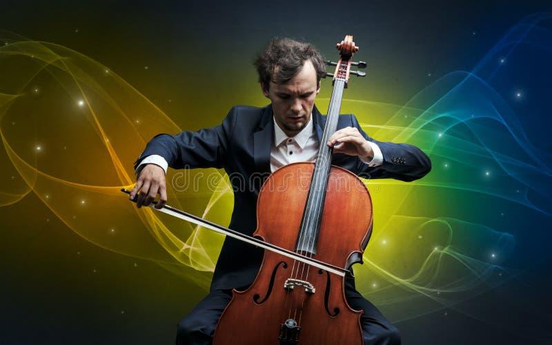 Cellist med färgrikt sago- begrepp arkivfoto