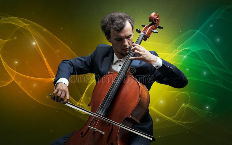Cellist med färgrikt sago- begrepp royaltyfri bild
