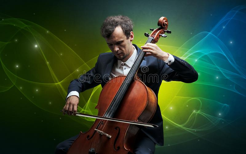 Cellist med färgrikt sago- begrepp arkivfoton