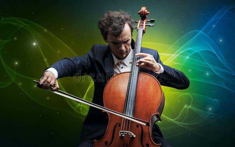 Cellist med färgrikt sago- begrepp royaltyfria bilder