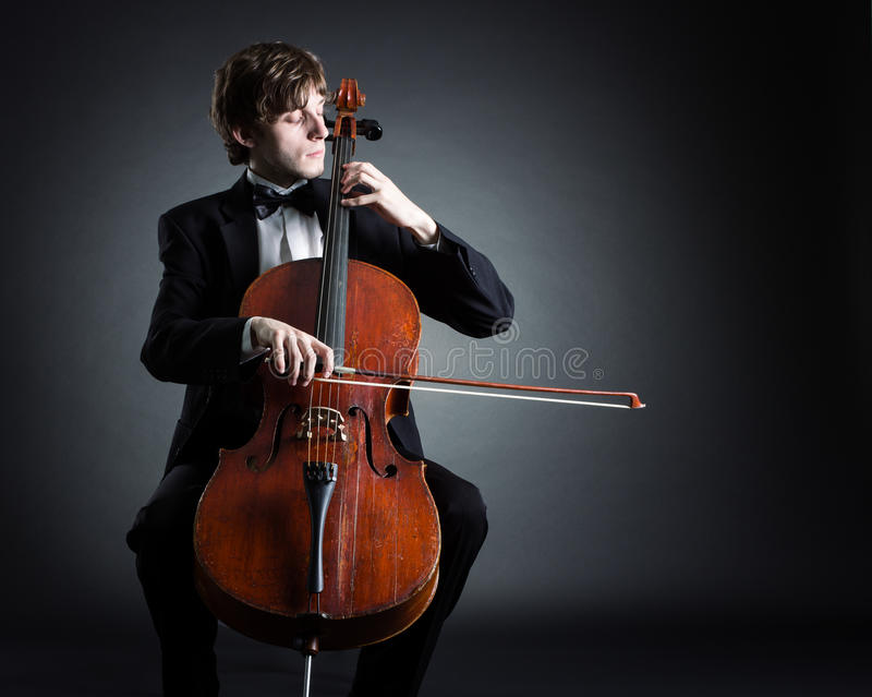 Cellist playing on cello royalty free stock images