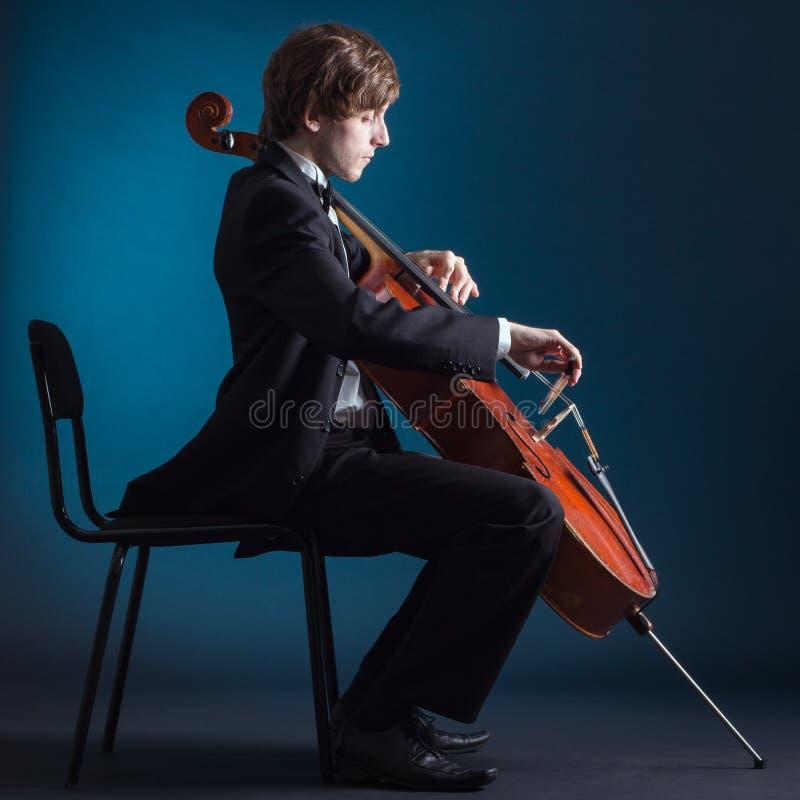 Cellist playing on cello stock photos