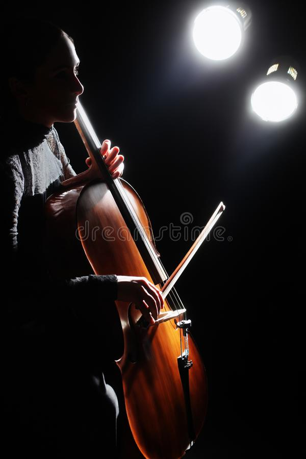 Cello player Cellist playing violoncello royalty free stock image