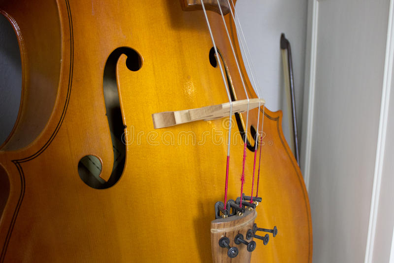 Cello bridge and tailpiece royalty free stock images