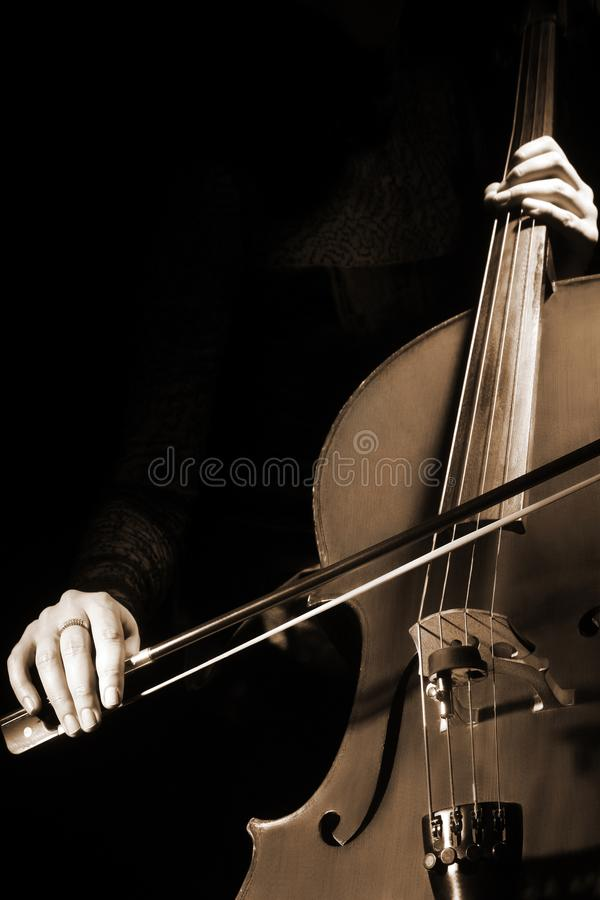 Cello player Cellist hands playing cello with bow royalty free stock image