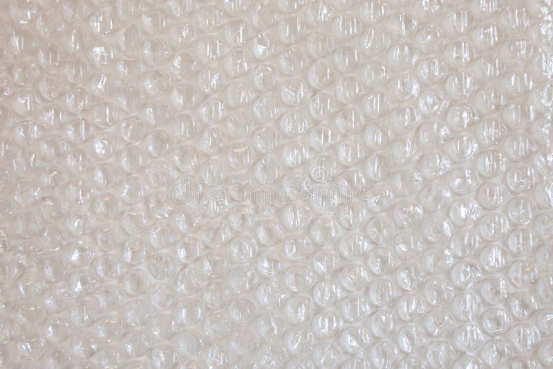 Cellophane en plastique de texture de fond enveloppant l'argent gris noir blanc de emballage en métal de boule de perle de paquet photo libre de droits