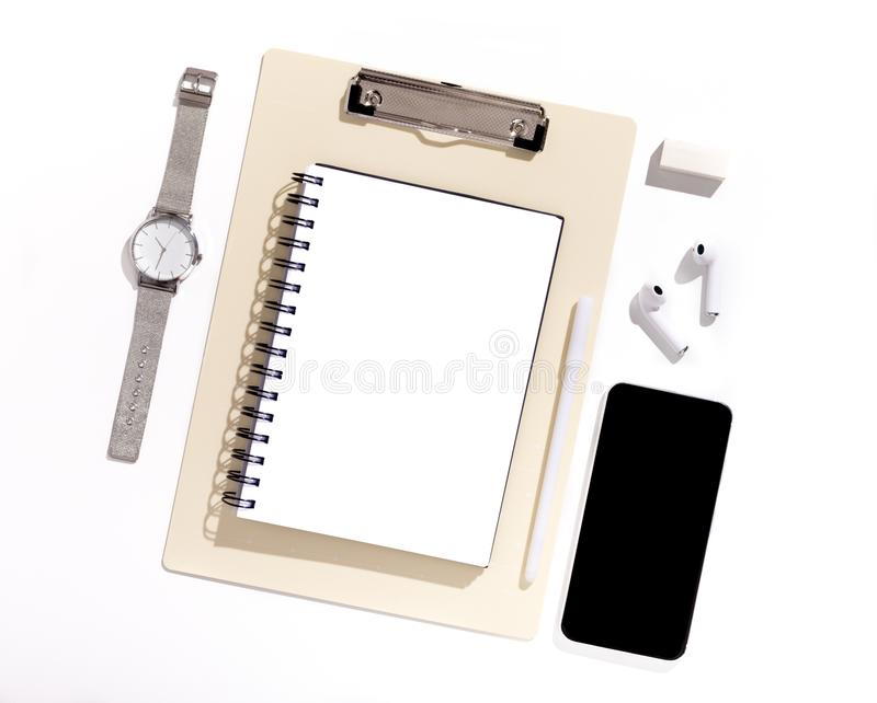 Cellphone with black blank screen on Office table with supplies royalty free stock photography