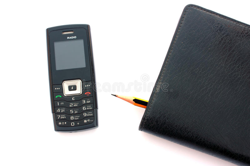 Cellphone and diary royalty free stock photography