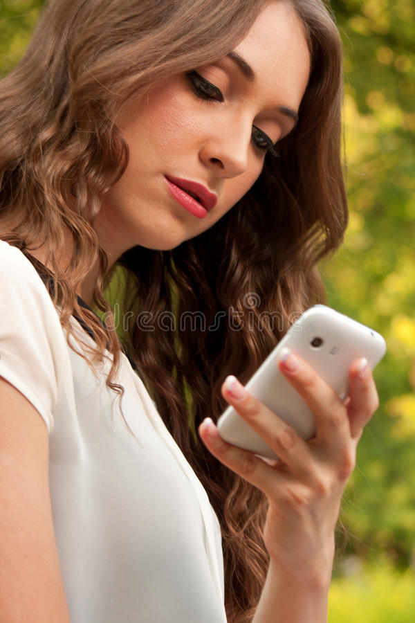 Download Cellphone in park stock image. Image of outside, face - 26319503