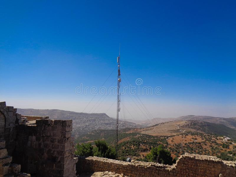 a cellphone tower on an ruin stock photo