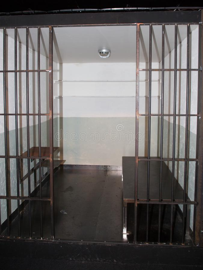 Prison cell with jail iron bars for criminals. Cells in an Old Grunge Prison seen through Jail Bars stock images